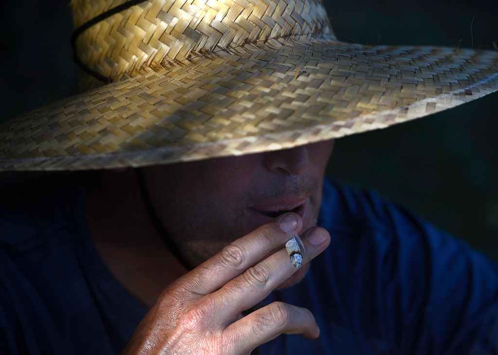. A man smokes a joint as the Monterey International Pop Festival Celebrates 50 Years at the Monterey County Fairgrounds and Event Center in Monterey on Saturday June 18, 2017. (David Royal - Monterey Herald)