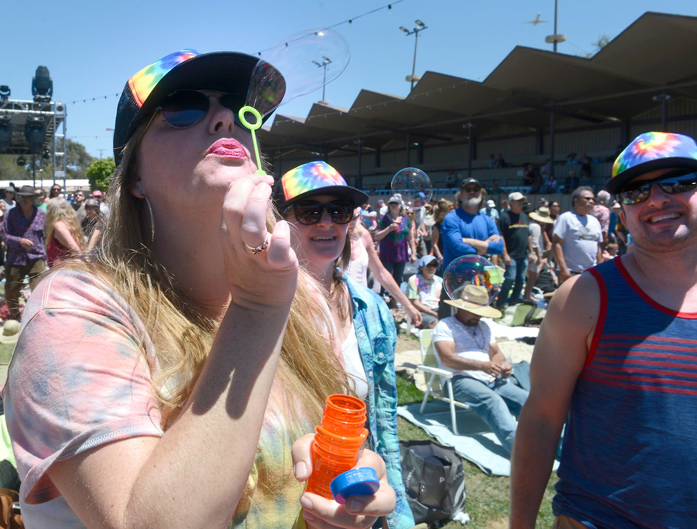 . Stefanie Starlett blows bubbles beside Jessica Guterman and Mike Badalov as the Monterey International Pop Festival Celebrates 50 Years at the Monterey County Fairgrounds and Event Center in Monterey on Saturday June 18, 2017. (David Royal - Monterey Herald)