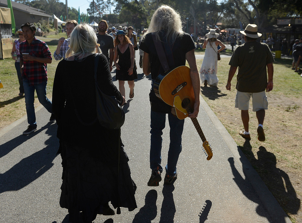 ". Hank ""12\"" walks with his guitar over his back while attending the Monterey International Pop Festival Celebrates 50 Years at the Monterey County Fairgrounds and Event Center in Monterey on Saturday June 18, 2017. (David Royal - Monterey Herald)"