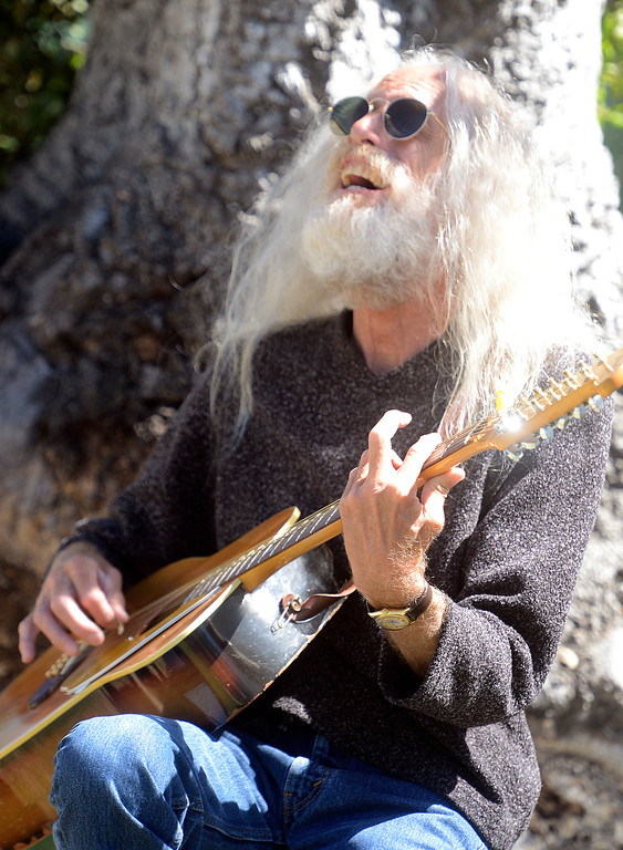 ". Hank ""12\"" plays guitar on an oak tree while attending the Monterey International Pop Festival Celebrates 50 Years at the Monterey County Fairgrounds and Event Center in Monterey on Saturday June 18, 2017. (David Royal - Monterey Herald)"