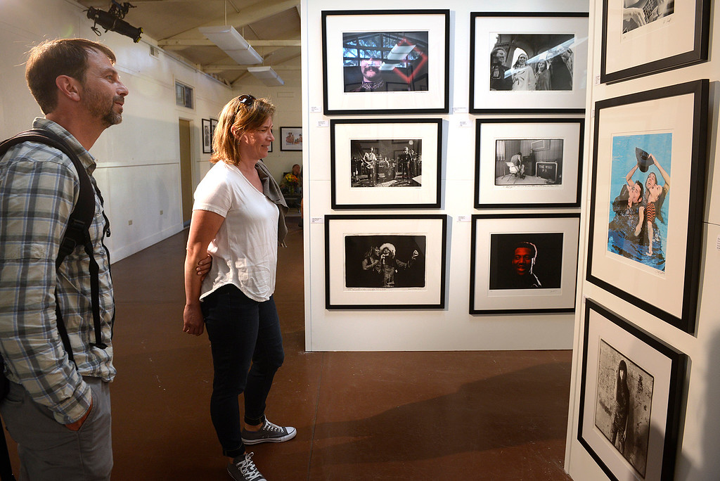 . Thomas Christensen and his wife Tiina look over photographs from the original Monterey Pop Festival photographers as the Monterey International Pop Festival Celebrates 50 Years at the Monterey County Fairgrounds and Event Center in Monterey on Friday June 16, 2017. (David Royal - Monterey Herald)