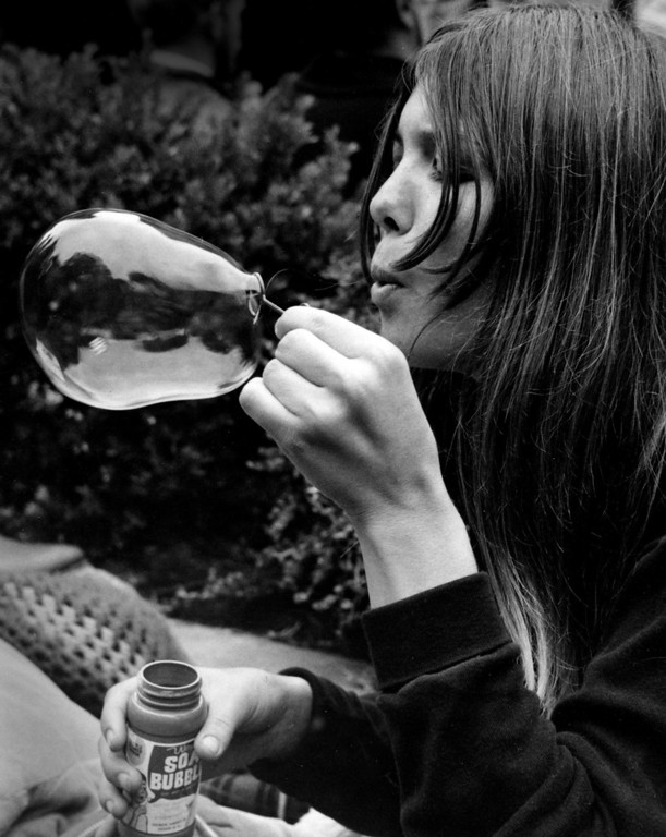 . A woman blows a bubble on Saturday, June 17, 1967 at the Monterey Fairgrounds during the Monterey International Pop Festival.  (Monterey Herald)