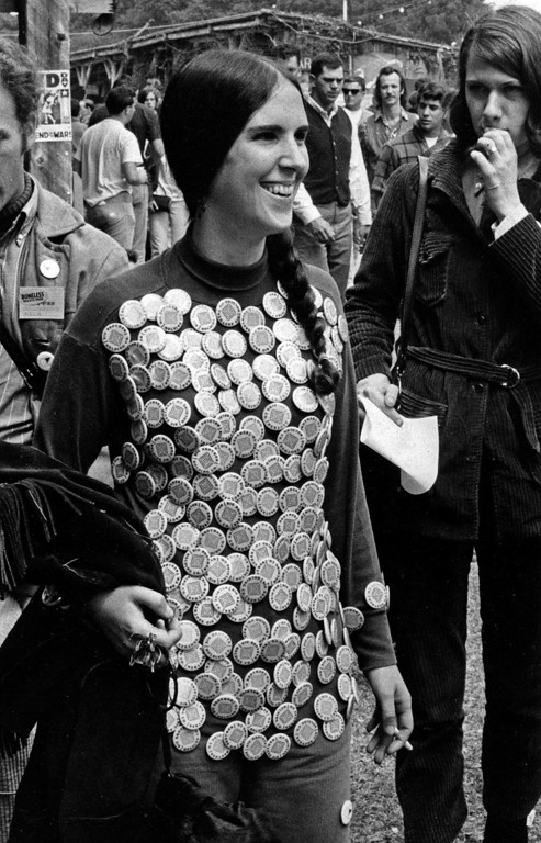 . A fan of Big Brother and the Holding Company, wears buttons all over her shirt on Friday, June 16, 1967 at the Monterey Fairgrounds during the Monterey International Pop Festival.  (Monterey Herald)
