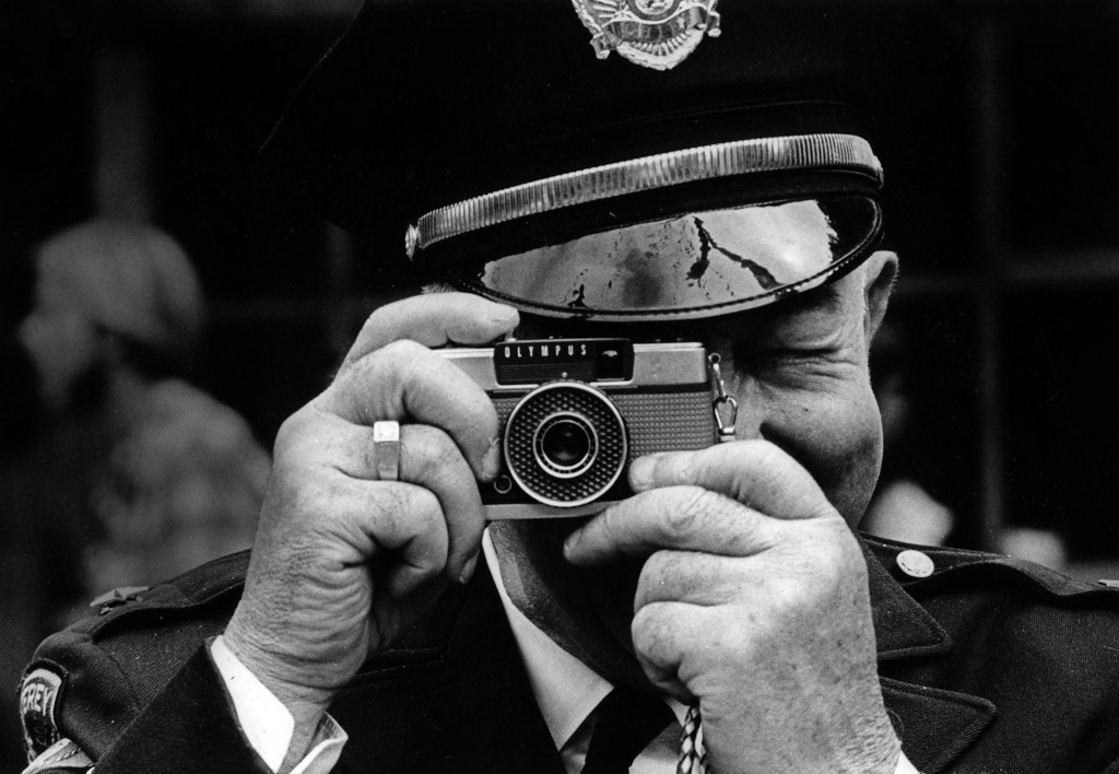 . Monterey Police chief Frank Marinello takes a picture of the scene on Sunday, June 18, 1967 at the Monterey Fairgrounds during the Monterey International Pop Festival.  (Monterey Herald)
