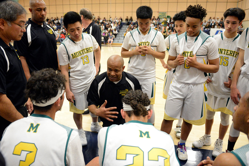 . Monterey coach Greg Daniels rallies his team against Miramonte during the opening round of the State Nor Cal Division III boys basketball tournament at CSU Monterey Bay on Wednesday March 8, 2017. (David Royal - Monterey Herald)
