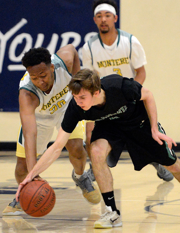 . Monterey\'s Mohammed Adam battles against Miramonte\'s Jayson Fernbacher during the opening round of the State Nor Cal Division III boys basketball tournament at CSU Monterey Bay on Wednesday March 8, 2017. (David Royal - Monterey Herald)