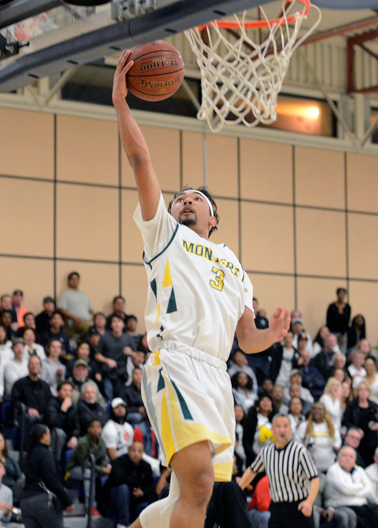 . Monterey\'s Kobe Ordonio shoots a basket against Miramonte during the opening round of the State Nor Cal Division III boys basketball tournament at CSU Monterey Bay on Wednesday March 8, 2017. (David Royal - Monterey Herald)