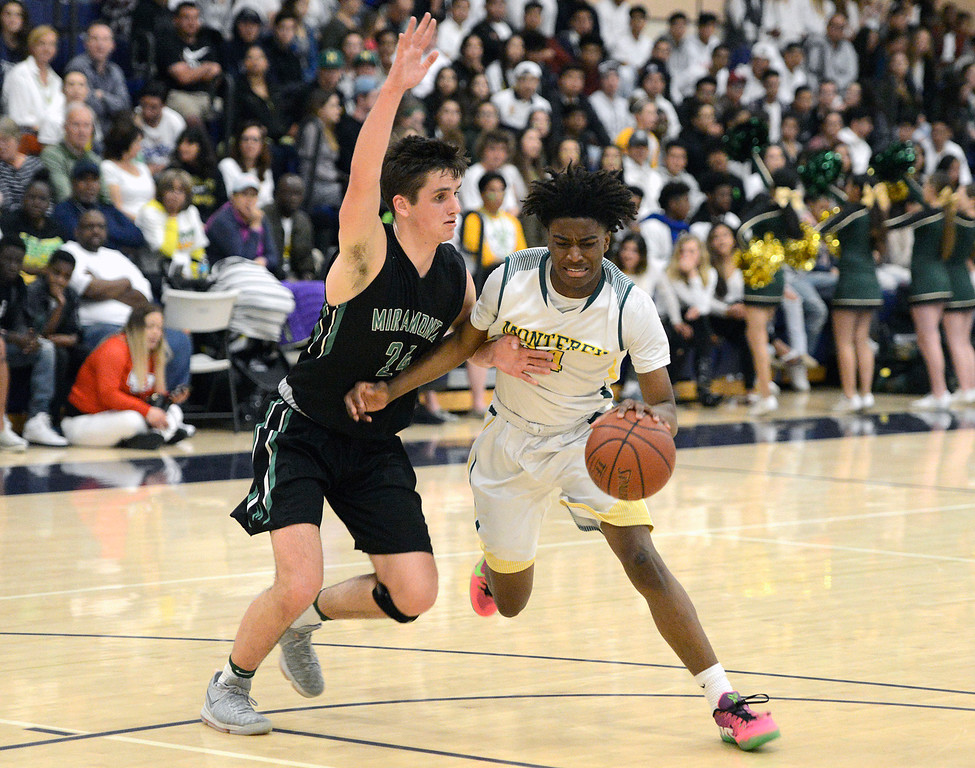 . Monterey\'s Evans Charles battles his way to the basket against Miramonte\'s Charlie Hocking during the opening round of the State Nor Cal Division III boys basketball tournament at CSU Monterey Bay on Wednesday March 8, 2017. (David Royal - Monterey Herald)