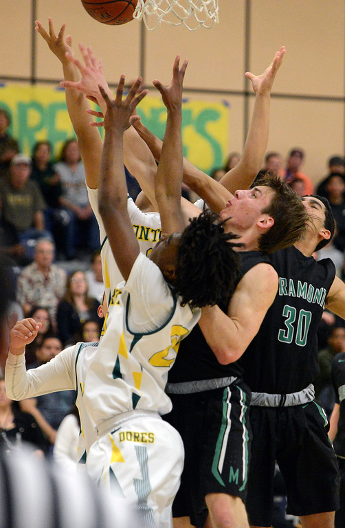 . Monterey\'s Evans Charles and teammates battle against Miramonte for a rebound during the opening round of the State Nor Cal Division III boys basketball tournament at CSU Monterey Bay on Wednesday March 8, 2017. (David Royal - Monterey Herald)