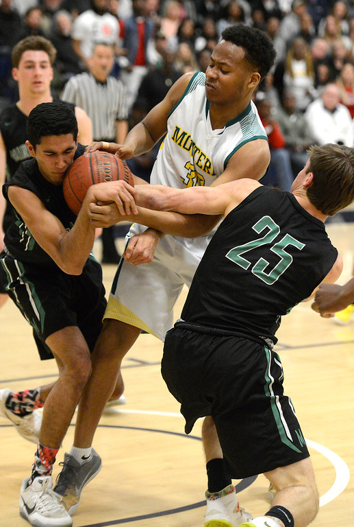 . Monterey\'s Mohammed Adam battles Miramonte\'s Nikhil Shastri, left and Nick Foster during the opening round of the State Nor Cal Division III boys basketball tournament at CSU Monterey Bay on Wednesday March 8, 2017. (David Royal - Monterey Herald)