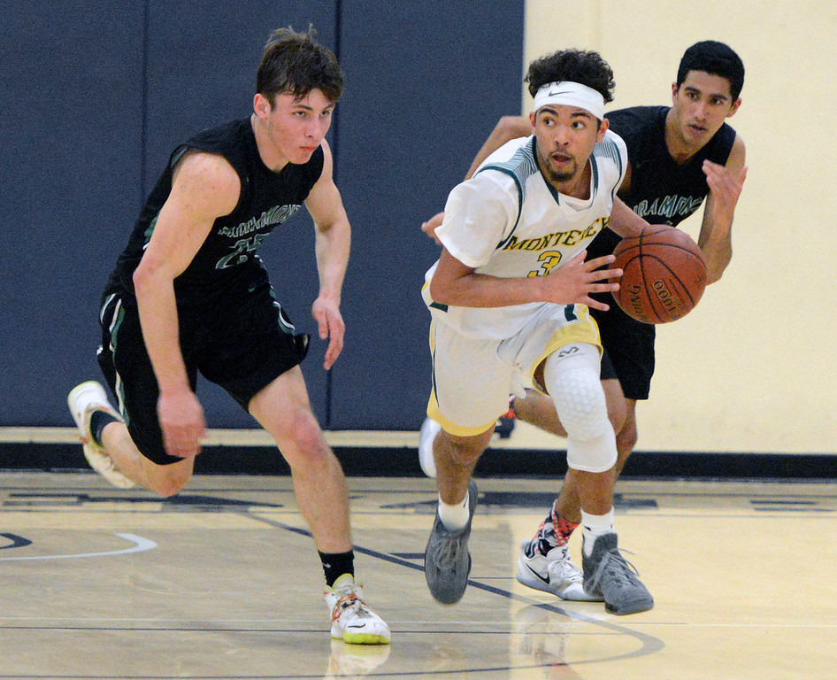 . Monterey\'s Kobe Ordonio moves the ball upcourt against Miramonte during the opening round of the State Nor Cal Division III boys basketball tournament at CSU Monterey Bay on Wednesday March 8, 2017. (David Royal - Monterey Herald)