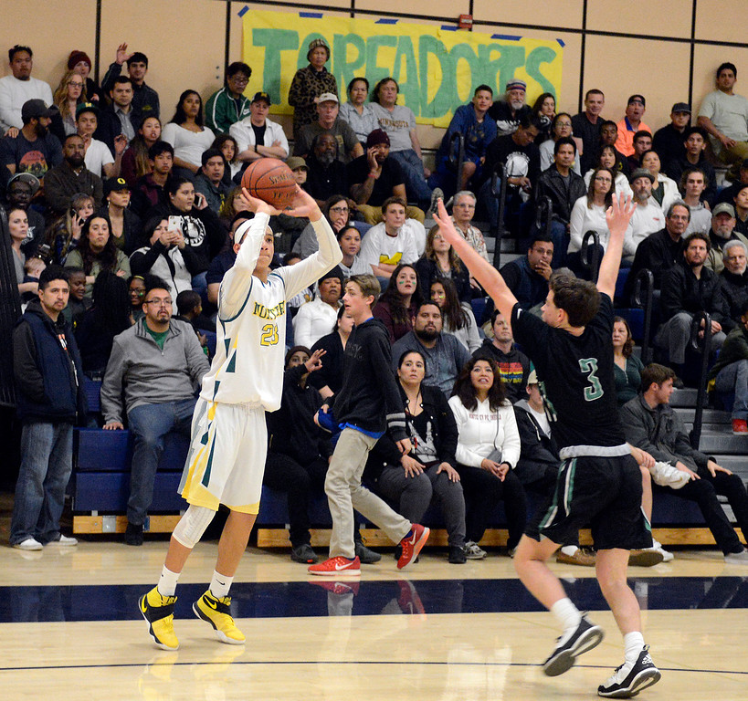 . Monterey\'s Tahjae Ordonio shoots a three pointer against Miramonte during the opening round of the State Nor Cal Division III boys basketball tournament at CSU Monterey Bay on Wednesday March 8, 2017. (David Royal - Monterey Herald)
