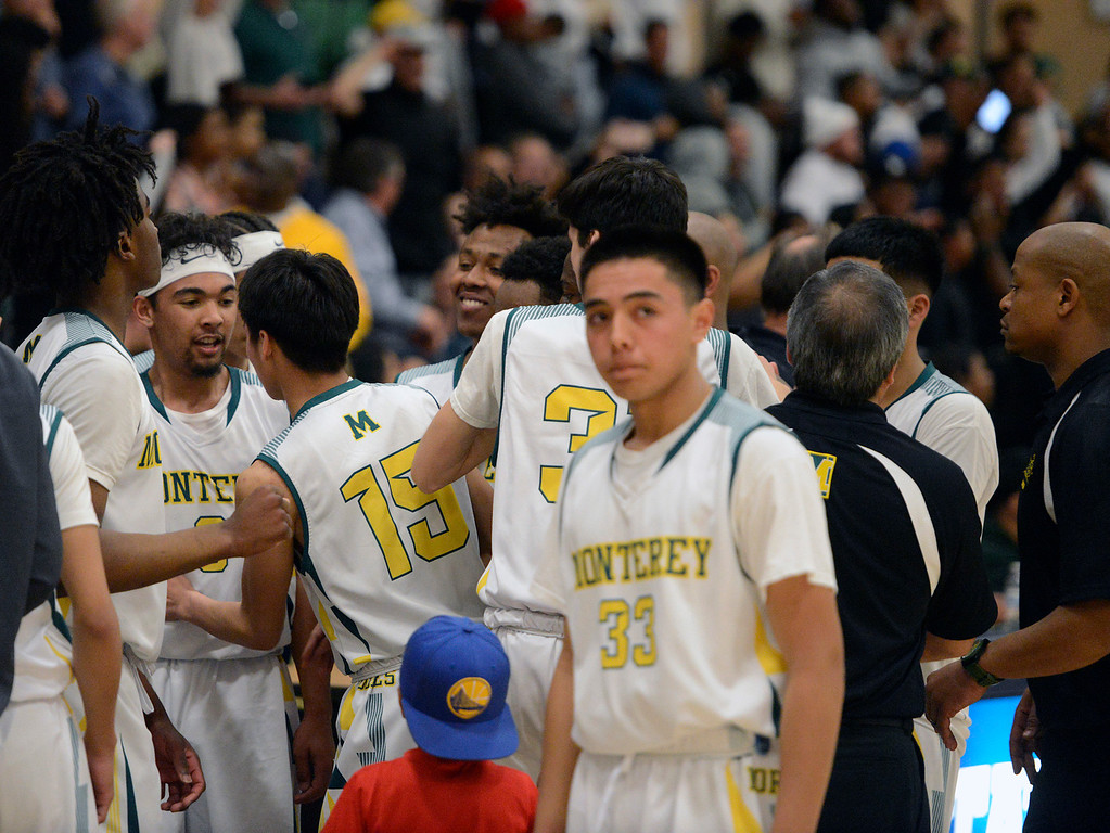 . Monterey players and coaches gather up before their team heads into overtime against Miramonte during the opening round of the State Nor Cal Division III boys basketball tournament at CSU Monterey Bay on Wednesday March 8, 2017. (David Royal - Monterey Herald)