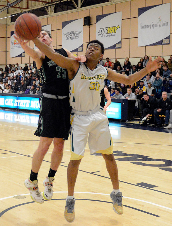 . Monterey\'s Mohammed Adam battles Miramonte\'s Nick Foster for a rebound during the opening round of the State Nor Cal Division III boys basketball tournament at CSU Monterey Bay on Wednesday March 8, 2017. (David Royal - Monterey Herald)