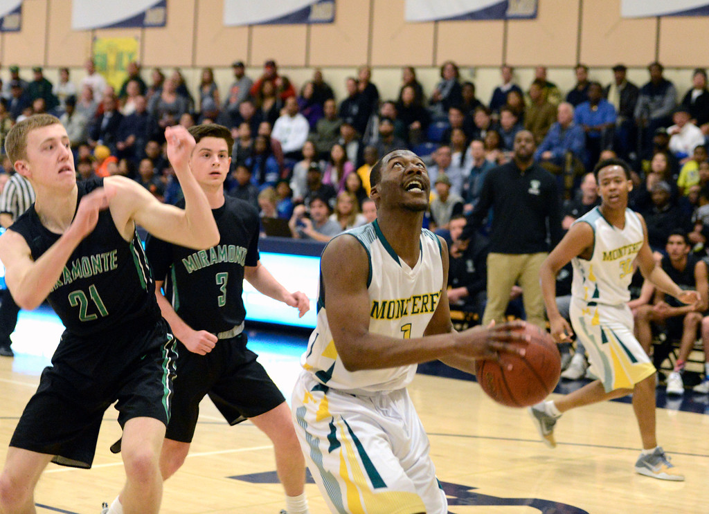 . Monterey\'s Austin White looks for a shot against Miramonte during the opening round of the State Nor Cal Division III boys basketball tournament at CSU Monterey Bay on Wednesday March 8, 2017. (David Royal - Monterey Herald)