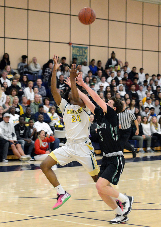 . Monterey\'s Evans Charles reels in a pass against Miramonte during the opening round of the State Nor Cal Division III boys basketball tournament at CSU Monterey Bay on Wednesday March 8, 2017. (David Royal - Monterey Herald)