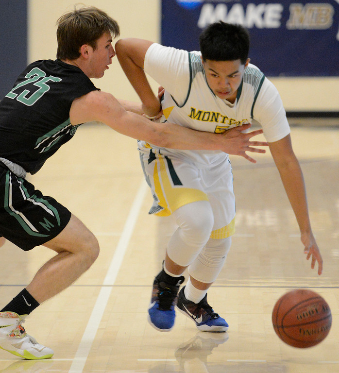 . Monterey\'s Edrin Arelis dribbles downcourt against Miramonte\'s Nick Foster during the opening round of the State Nor Cal Division III boys basketball tournament at CSU Monterey Bay on Wednesday March 8, 2017. (David Royal - Monterey Herald)