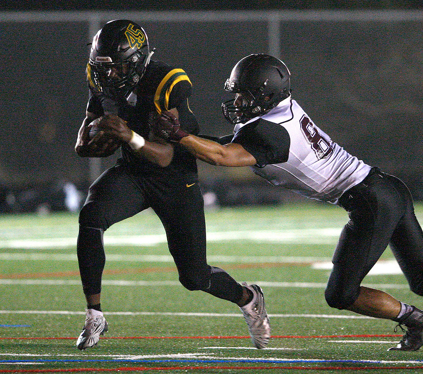 . Monterey High School\'s (45) avoids Sobrato High School\'s Gunnar Vereyken (87) in the first-half  during their game in Monterey on Friday, September 7, 2018.  (Vern Fisher - Monterey Herald)