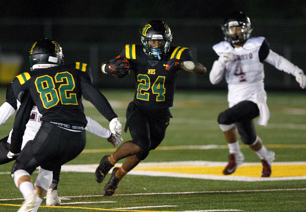. Monterey High School\'s Timothy Byrd (24) runs for yards in the first-half during their game against Sobrato High School in Monterey on Friday, September 7, 2018.  (Vern Fisher - Monterey Herald)