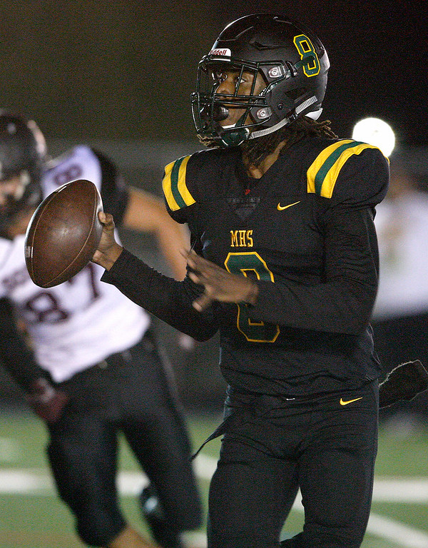 . Monterey High School\'s Evans Charles (8) looks for a receiver during their game against Sobrato High School in Monterey on Friday, September 7, 2018.  (Vern Fisher - Monterey Herald)