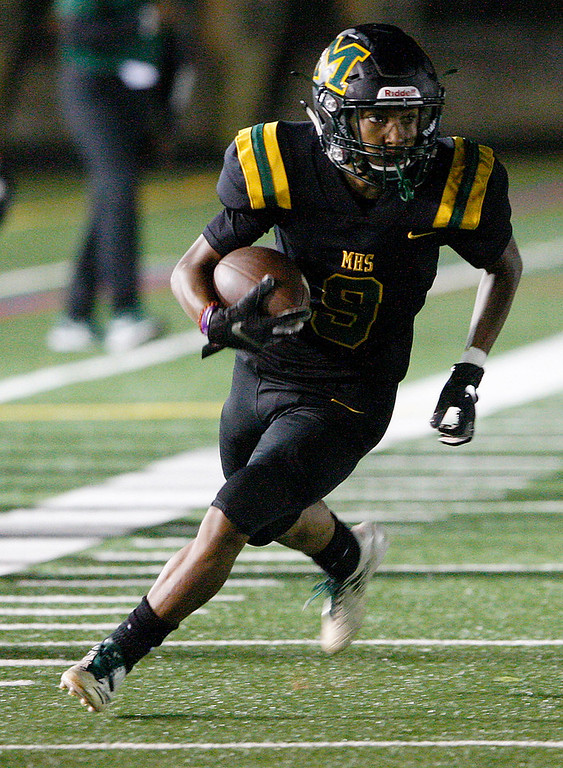 . Monterey High School\'s Eris Hutchins (9) runs for yards in the first-half during their game against Sobrato High School in Monterey on Friday, September 7, 2018.  (Vern Fisher - Monterey Herald)