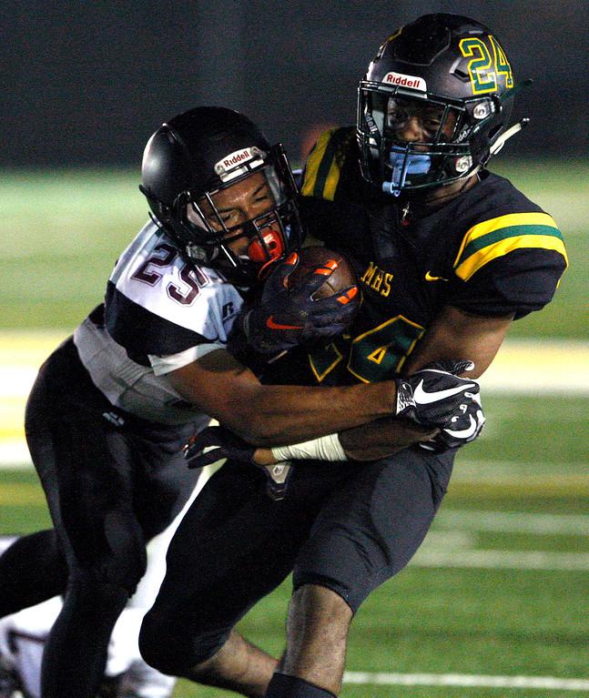 . Sobrato High School defender Jesse Redmond (25) brings down Monterey High School\'s Timothy Byrd (24) during their game in Monterey on Friday, September 7, 2018.  (Vern Fisher - Monterey Herald)