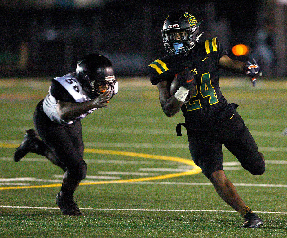 . Monterey High School\'s Timothy Byrd (24) runs for yards in the first-half past Sobrato High School defender Orion Woods (50) during their game in Monterey on Friday, September 7, 2018.  (Vern Fisher - Monterey Herald)
