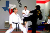"I was honored to have been invited to Nancy's black belt test, but arrived only in time to see Nancy's last kick - when she accidentally kicked her teacher in the head. :) Full pics <a href=""http://ihatepink.smugmug.com/gallery/1557245"">here</a>."