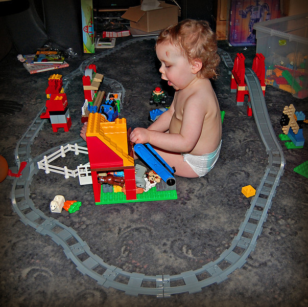 Bethan plays with her new trainset