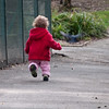 Bethan chases a pigeon in a park near Charlton