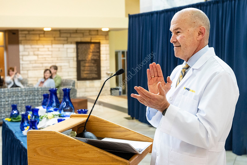 Vice President & Executive Dean for Health Sciences Clay B. Marsh applauds Doctors, Researchers, Faculty and Staff as they come together at the HSC Pylons common area for the Health Sciences Vice President's Awards April 10, 2019. Photo Greg Ellis.