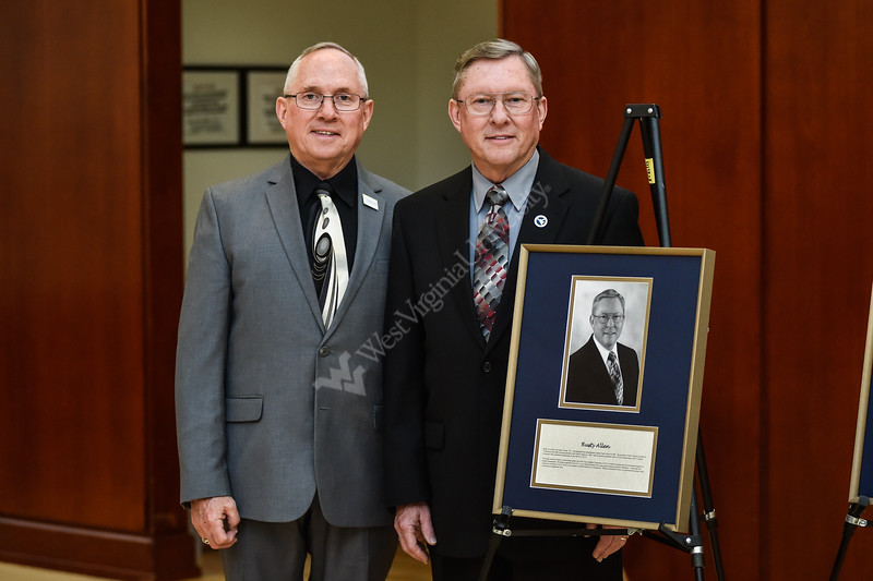 Chet Allen and Rusty Allen, both now members of the WV Academy of Civil Engineers,  stand proudly next to the plaque recognizing Rusty Allen's induction into the Academy. Students and staff of the Statler College of Engineering gathered at the Erickson Alumni Center to recognize major accomplishments. Scholarships were awarded and individuals were recognized for their achievements. The event was held on April 26, 2019.