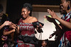Damilola Fasinu, a design and merchandising graduate student at the Davis College dances with models during the launch of her fahion line, Gbajumo Fashion at African Night in the Mountainlair April 6th, 2019.  Photo Brian Persinger