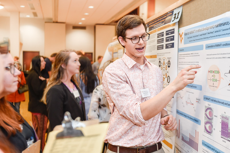 David Sokolov, an undergraduate student of the Eberly College of Arts and Sciences presents his research at the Spring Research Symposium held in the Mountainlair Ballroom on April 13, 2019.