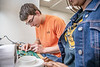 Tanner Gorby, a Mechanical and Aerospace Engineering major makes repairs during the Hovercraft Competition at WVU Demo Day in the Engineering Sciences Building April, 25th 2019.  Photo Brian Persinger