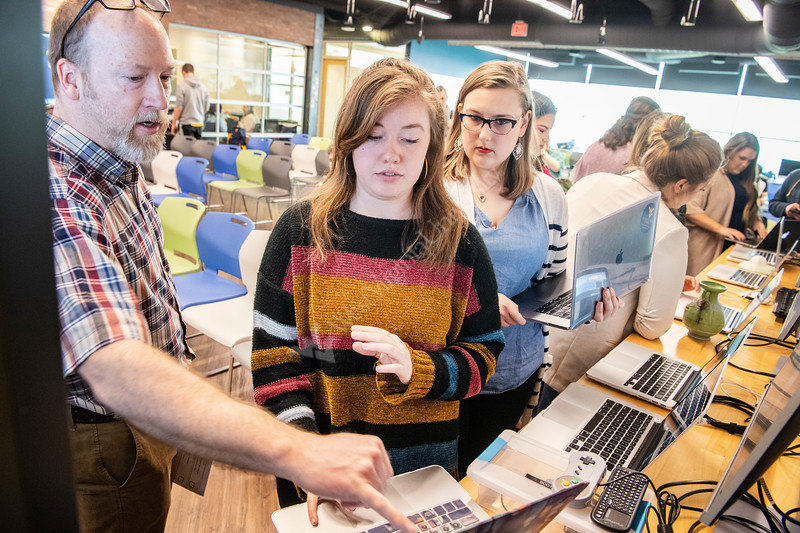 Assistant Professor Jeffrey Moser assists Ruthie Deely, a Strategic Communications major in preparing her website for part of the Video Game Competition during WVU Demo Day at Evansdale Crossing  April, 25th 2019.  Photo Brian Persinger