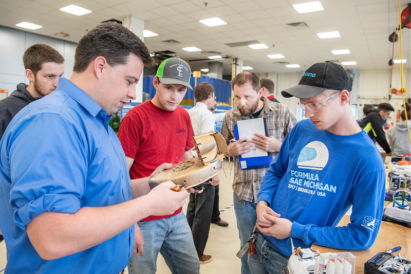 Teaching Instructor and Prototyping Shop Manager Shanti Hamburg (far left) assists in reprogramming the speed controls during the Hovercraft Competition at WVU Demo Day in the Engineering Sciences Building April, 25th 2019.  Photo Brian Persinger