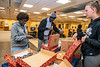 Members of the Office of the Provost and the Division of University Relations offer coffee and donuts to Kamala Hill, an MDS major and Samual Oguafuye, a Mechanical and Aerospaoce Engineering major at the Evansdale Library during a day long campus wide Research Celebration, Friday April 5th, 2019. Photo Brian Persinger