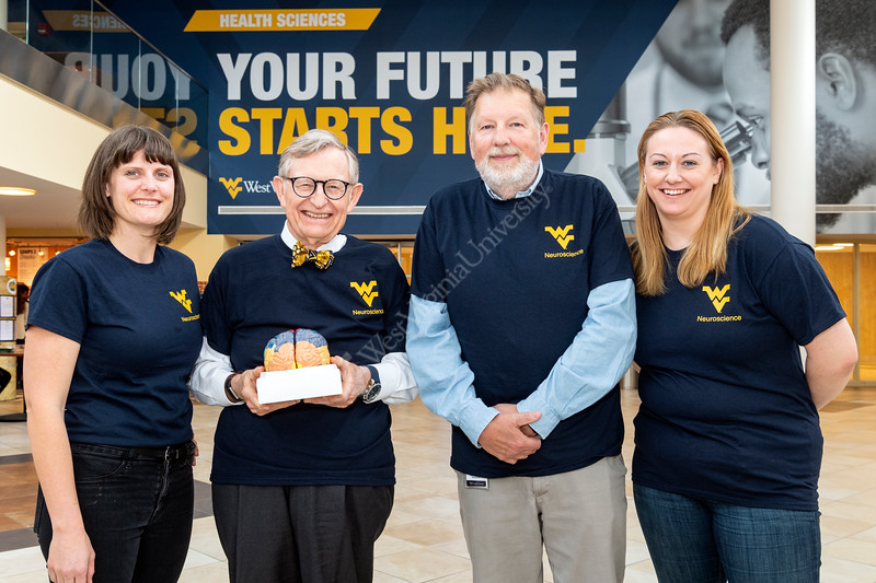WVU President E. Gordon Gee poses with students amd faculty at the Feed Our Brains event HSC April 17, 2019. Photo Greg Ellis