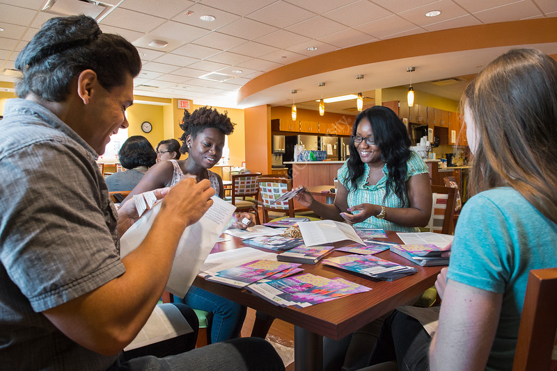 31157; 0078xx l to r stephan brooks, mph social behavior health, toska copper, mph social behavior health, sabna thomas, phd, sbhs, social behavior health, angela dyer, phd, social behavior health participate in day of service, at the rosenbaum house stuffs mail flyers for rosenbaum house. This is part of the wvu school of public health's community out reach.