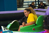 First year student Jessica Ingabire drives her bumper car toward her friend during the Mountaineer Midway carnival August 13, 2017 in the WVU Student Recreation Center. The Mountaineer Midway takes place every year as a part of West Virginia University's Welcome Week.
