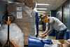 Conservation Specialist Stephanie Toothman of WVU Sustainability applies stickers to recycling bins in the Mountainlair August 25th, 2020.  (WVU Photo/Brian Persinger)