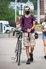 WVU Freshman Noha Hower Mechanical Engineering, Shippensburg Pa. walks his bike on the Downtown as students return to the WVU Campus for the first day of classes during the Covid-19 pandemic August 26, 2020. (WVU Photo/Greg Ellis)