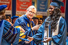 Easter Kith, Excercise Physiology major in the School of Medicine is congatulated by Provost and Vice President for Academic Affairs Joyce McConnell as she walks across the platform during December Commencement in the Coliseum December 15th, 2018.  Photo Brian Persinger