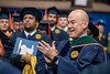 Vice President & Executive Dean for Health Sciences Clay Marsh celebrates upon entering December Commencement in the Coliseum December 15th, 2018.  Photo Brian Persinger