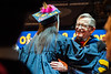 Alayna Fuller shares a moment with WVU President E. Gordon Gee along with other WVU graduates from the Eberly College of Arts and Science and the John Chambers College of Business and Economics as they convene with their families and faculty for the December 2018 Commencement at the WVU Coliseum , December 12, 2018. Photo Greg Ellis