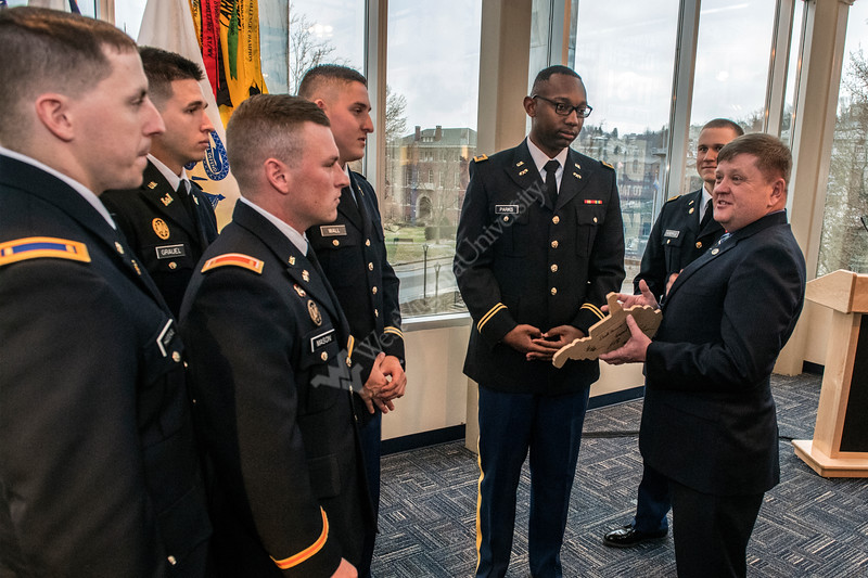 Army Lieutenant Colonel (Retired) Mitch MCoy, alumni and commissionee from the Moutaineer Batallion talks with recently commissioned cadets about carrying the banner and serving the mountaineer spirit  after the Army ROTC Commissioning ceremony in the Mountaineer Room of the Mountainlair December 14th, 2017.  Photo Brian Persinger
