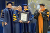 December Commencement speaker Wes Bush receives an HDR from WVU President E Gordon Gee and faculty December 15, 2017. Photo Greg Ellis
