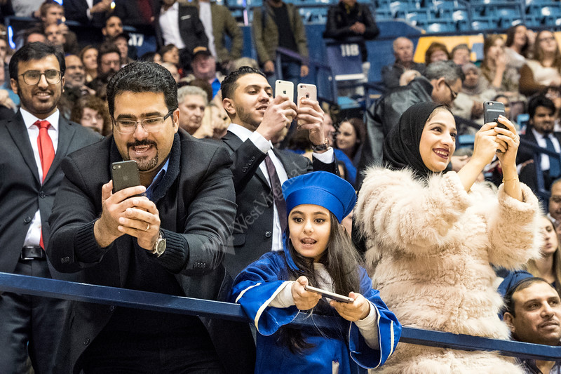 Amjad Khavabah  daughter Ghazal and friends make pictures and share the excitement of commencement,  Amjad's wife graduated with a degree in Industrial Management December 15, 2017. Photo Greg Ellis