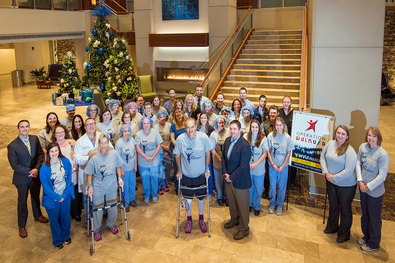 WVU doctors, nurses and patients pose for a photo as part of Operation Walk USA   in the Rudy Hospital Lobby December7, 2017; Photo Greg Ellis